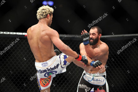 Johny Hendricks, Josh Koscheck Johny Hendricks, right, in action against Josh Koschek during their bout at UFC on Fox at the Izod Center in E. Rutherford, NJ on . Hendricks won via split decision