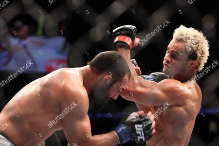 Johny Hendricks, Josh Koscheck Johny Hendricks, left, in action against Josh Koschek during their bout at UFC on Fox at the Izod Center in E. Rutherford, NJ on . Hendricks won via split decision