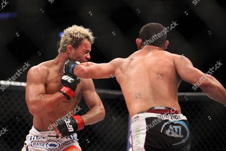 Josh Koscheck, Johny Hendricks Johny Hendricks lands a left hand against Josh Koscheck during their welterweight bout at UFC on Fox at the Izod Center in E. Rutherford, NJ on . Hendricks won via 3-round split decision