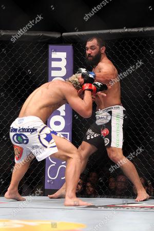 Josh Koscheck, Johny Hendricks Johny Hendricks, right, lands a punch against Josh Koscheck during their welterweight bout at UFC on Fox at the Izod Center in E. Rutherford, NJ on . Hendricks won via 3-round split decision