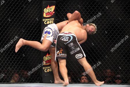 Johny Hendricks, Josh Koscheck Johny Hendricks grapples against Josh Koschek during their bout at UFC on Fox at the Izod Center in E. Rutherford, NJ on . Hendricks won via split decision