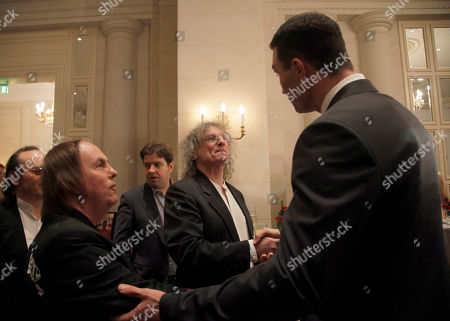 Wladimir Klitschko, Dave Hill, Don Powell Heavyweight World Boxing Champion Wladimir Klitschko, right, greets Dave Hill, left, and Don Powell, center, guitarist and drummer of the legendary British rock group Slade and guests of the Charity Gala Dinner of Klitschko Brothers Foundation in Kiev, Ukraine, . Hill and Powell donated a guitar with their autographs for the charity auction. Funds raised from the auction were planned for children sports and education in Ukraine