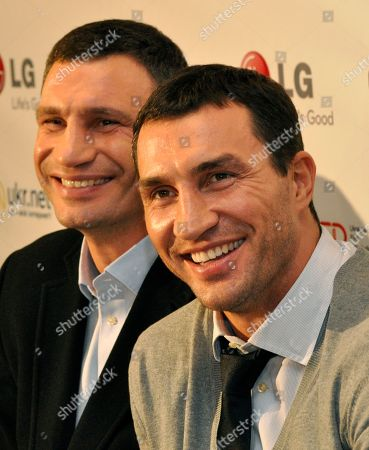 """Stock Image of Vitali Klitschko, Wladimir Klitschko Ukrainian boxer Vitali Klitschko, left, with his brother Wladimir responds to questions in Kiev, Ukraine, during a news conference after the Ukrainian premiere of the documentary """"Klitschko"""", directed by Sebastian Dehnhardt, which follows their careers from childhood to heavyweight success"""