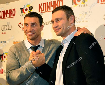 """Stock Photo of Vitali Klitschko, Wladimir Klitschko Ukrainian boxer Vitali Klitschko, left, with his brother Wladimir pose for photographers in Kiev, Ukraine, during a news conference after the Ukrainian premiere of the documentary """"Klitschko"""", directed by Sebastian Dehnhardt, which follows their careers from childhood to heavyweight success"""
