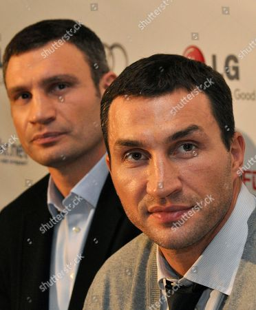 """Vitali Klitschko, Wladimir Klitschko Ukrainian boxer Vitali Klitschko, left, with his brother Wladimir responds to questions in Kiev, Ukraine, during a news conference after the Ukrainian premiere of the documentary """"Klitschko"""", directed by Sebastian Dehnhardt, which follows their careers from childhood to heavyweight success"""