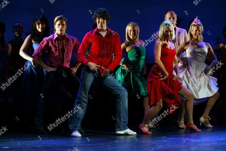 Footloose The Musical, featuring Miria Parvin (Ariel Moore) and Tommy Sherlock (Ren McCormack, both wearing red)