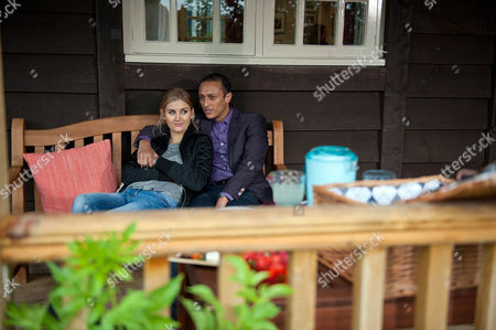 Jai Sharma, as played by Chris Bisson, and Holly Barton, as played by Sophie Powles, have a picnic in a field, Holly tells him her plan to save the farm whilst Jai suggests they could take their relationship public. (Ep 7627 - Wednesday 28th September 2016)