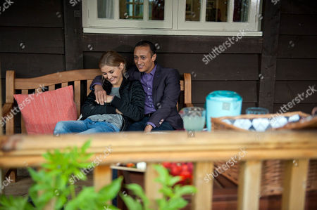 Stock Image of Jai Sharma, as played by Chris Bisson, and Holly Barton, as played by Sophie Powles, have a picnic in a field, Holly tells him her plan to save the farm whilst Jai suggests they could take their relationship public. (Ep 7627 - Wednesday 28th September 2016)
