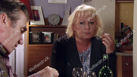 Stock Photo of In a bid to put their argument behind them, Eileen Grimshaw, as played by Sue Cleaver, asks Vinny, as played by Ian Kelsey, to stay for tea. But when she reveals that she's left Streetcars so she can spend more time on the building project, Vinny is even more furious. (Ep 9005 - Monday 3rd October 2016)