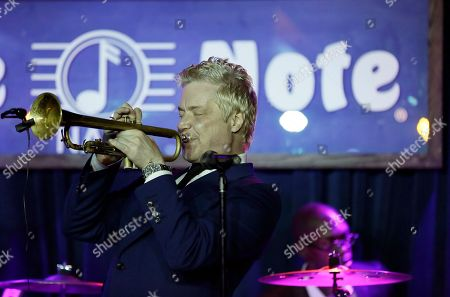 Stock Image of Chris Botti, Lee Pearson Chris Botti performs during the opening night of the Blue Note jazz club in Napa, Calif. The Napa venue is the newest location for Blue Note which began in New York City in 1981. On the drums at right is Lee Pearson