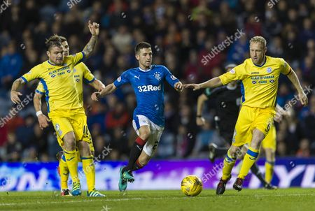 Jason Holt of Rangers with Paul Paton (l) & Steven Anderson of St. Johnstone (r) during the SPFL Ladbrokes Premiership match between Rangers & St. Johnstone at Ibrox Stadium, Glasgow on 26th October