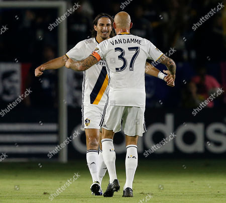 Jelle Van Damme, Alan Gordon Los Angeles Galaxy defender Jelle Van Damme (37) congratulates forward Alan Gordon (9) for scoring against the Real Salt Lake during the first half of a knockout round MLS playoff soccer match in Carson, Calif
