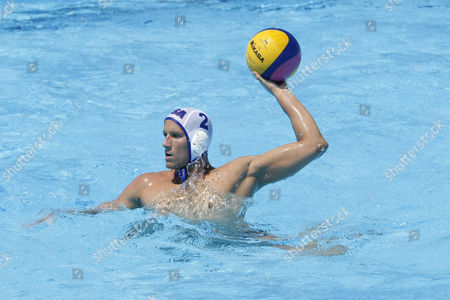 USA team player Peter Varellas competing in the preliminary round of the men's waterpolo at the 13th Fina World Aquatics Championships held in the The Foro Italico Swimming Complex.