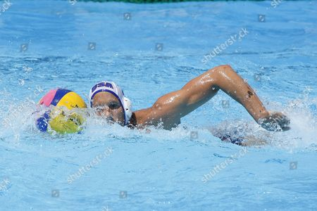 USA team player Peter Varellas swims with the ball while competing in the preliminary round of the men's waterpolo at the 13th Fina World Aquatics Championships held in the The Foro Italico Swimming Complex.