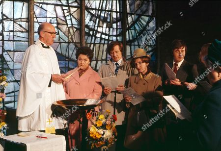 The christening of Tracy Langton. Richard Caldicot (as Rev. Smedley), Betty Driver (as Betty Turpin), William Roache (as Ken Barlow), Eileen Derbyshire (as Emily Bishop) and Neville Buswell (as Ray Langton)