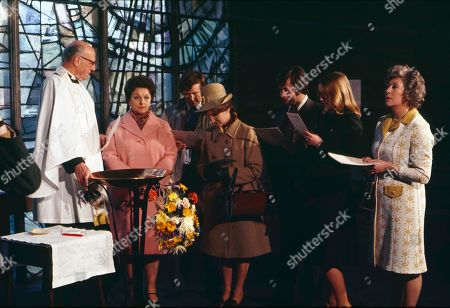 The christening of Tracy Langton. Richard Caldicot (as Rev. Smedley), Betty Driver (as Betty Turpin), William Roache (as Ken Barlow), Eileen Derbyshire (as Emily Bishop), Neville Buswell (as Ray Langton), Anne Kirkbride (as Deirdre Langton) and Maggie Jones (as Blanche Hunt)