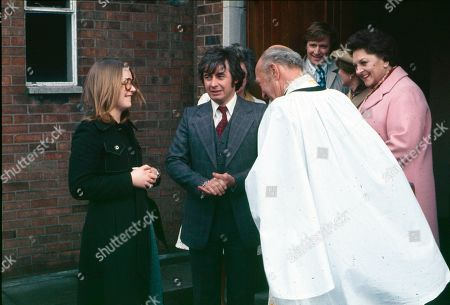 The christening of Tracy Langton. Anne Kirkbride (as Deirdre Langton), Neville Buswell (as Ray Langton), Richard Caldicot (as Rev. Smedley), William Roache (as Ken Barlow), Eileen Derbyshire (as Emily Bishop) and Betty Driver (as Betty Turpin)