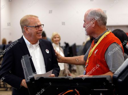 Ted Strickland Ohio Democratic Senate candidate and former Ohio Gov. Ted Strickland, left, greets a pole worker before voting at the Franklin County Board of Elections, in Columbus, Ohio. Strickland seeks to unseat Republican incumbent Rob Portman