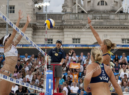 Lucy Boulton & Denise Johns (GBR) vs Heather Bansley & Elizabeth Maloney (CAN) during the FIVB International Beach Volleyball tournament, part of the London prepares (LOCOG) 2012 Olympic test events held at Horse Guards Parade, Westminster, London.