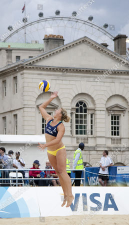 Lucy Boulton (GBR) serves with the Millenium wheel in the background during the FIVB International Beach Volleyball tournament, part of the London prepares (LOCOG) 2012 Olympic test events held at Horse Guards Parade, Westminster, London.