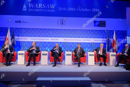 """The Director of Defence and International Security, Foreign and Commonwealth Office of United Kingdom, Peter Jones (2L), the Director of International Centre for Defence and Security of Estonia, Juri Luik (3L), the Secretary for Foreign Relations and Advisor to the President of Georgia, Tengiz Pkhaladze (3R9, the Former Minister of Defense of the Kingdom of Sweden, Sten Tolgfors (2R) and the Ministry of Foreign Affairs of the Republic of Poland, Marek Ziolkowski (R) attend the plenary session named """"NATO post-Warsaw"""""""