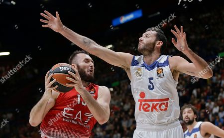 EA7 Emporio Armani Milan's Milan Macvan, left, is challenged by Real Madrid's Rodolfo Fernandez Rudy during a Euroleague basketball match between EA7 Emporio Armani Milan and Real Madrid in Assago, near Milan, Italy