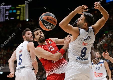 Stock Picture of From left, Real Madrid's Rodolfo Fernandez Rudy, EA7 Emporio Armani Milan's Krunoslav Simon and Real Madrid's Felipe Reyes go for the ball during a Euroleague basketball match between EA7 Emporio Armani Milan and Real Madrid in Assago, near Milan, Italy