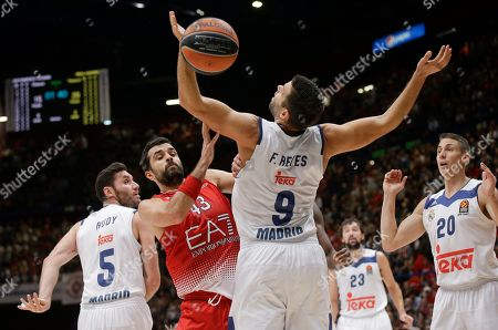 From left, Real Madrid's Rodolfo Fernandez Rudy, EA7 Emporio Armani Milan's Krunoslav Simon and Real Madrid's Felipe Reyes go for the ball during a Euroleague basketball match between EA7 Emporio Armani Milan and Real Madrid in Assago, near Milan, Italy