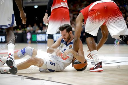 Stock Photo of Real Madrid's Rodolfo Fernandez Rudy, left, and EA7 Emporio Armani Milan's Jamel McLean vie for the ball during a Euroleague basketball match between EA7 Emporio Armani Milan and Real Madrid in Assago, near Milan, Italy