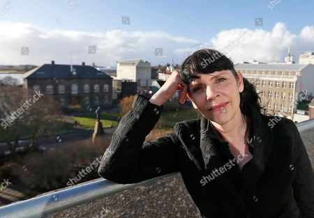 Birgitta Jonsdottir of the Pirate party poses in front of the parliament, Althing, in Reykjavik, Iceland, . Parliamentary elections will be held in Iceland on Oct. 29, 2016, more than 250,000 voters are called to elect the new parliament, 63 members of the Althing