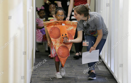 Leah Sack Ellie Taylor, 4, is dressed in a Halloween costume as Leah Sack helps her practice trick or treating with her classmates at The University of Texas at Dallas' Callier Center for Communication Disorders preschool class in Dallas, . Taylor and her classmates are part of a classroom-based speech, language and communication program for children with Autism Spectrum Disorder. In the week leading up to Halloween, the children are practicing trick-or-treating. The class helps autistic children better communicators while working to prevent behaviors that could interfere with learning and relationships