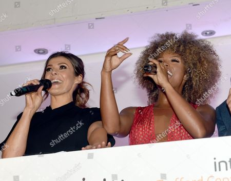 Stock Picture of Fleur East switches on the lights with Kym Marsh and j Mike Toolan.