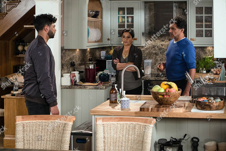 Stock Image of When Sharif Nazir, as played by Marc Anwar, finds Dev reading the gym accounts, he quickly whisks them off him and assures him that he'll look after the books. Having printed off another set, Dev shows Zeedan Nazir, as played by Qasim Ahktar, the gym accounts which show a transfer of £14k to Sharif's personal account. Zeedan's shocked. Entering No.6, Zeedan confronts Sharif and demands to know what's going on. (Ep 9024 - Monday 31st October 2016)