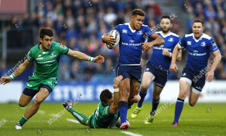 Stock Picture of Leinster's Adam Byrne is tackled by Tiernan O?Halloran (L) and Craig Ronaldson of Connacht