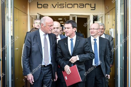 French prime minister Manuel Valls and Nouvelle Aquitaine president Alain Rousset leave I2S entreprise in Pessac near Bordeaux. I2S is specialized in imagery technology