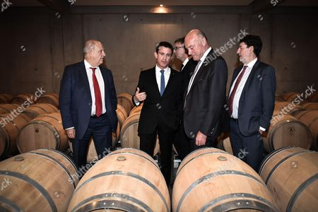 French prime minister Manuel Valls, deputy Gilles Savary, Nouvelle Aquitaine president Alain Rousset and Merignac mayor Alain Anziani visit the chai at Luchey Halde wine castle in Merignac