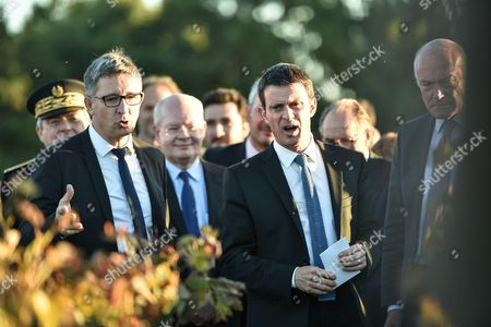 French prime minister Manuel Valls and Nouvelle Aquitaine president Alain Rousset walk in vineyard as he visits Luchey Halde wine castle in Merignac