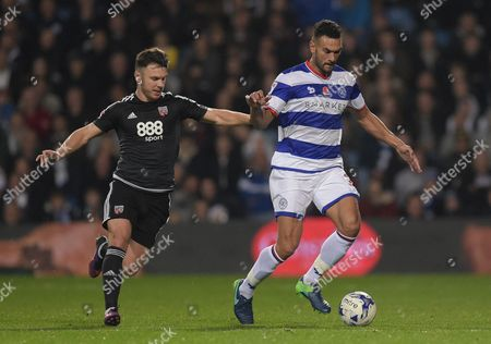 Scott Hogan of Brentford and Steven Caulker of QPR during the Sky Bet Championship match between QPR and Brentford played at Loftus Road, London on 28th October 2016