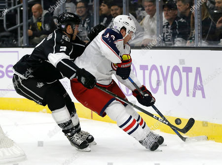 Brayden McNabb, Scott Hartnell Los Angeles Kings defenseman Brayden McNabb (3) battles Columbus Blue Jackets left wing Scott Hartnell (43) for the puck during the third period of an NHL hockey game in Los Angeles, . The Kings won 3-2, in overtime