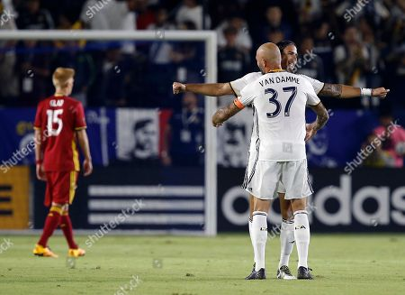 Jelle Van Damme, Alan Gordon, Justen Glad Los Angeles Galaxy defender Jelle Van Damme (37) hugs and congratulates forward Alan Gordon, right, for scoring as Real Salt Lake defender Justen Glad (15) walks away during the first half of a knockout round MLS playoff soccer match in Carson, Calif