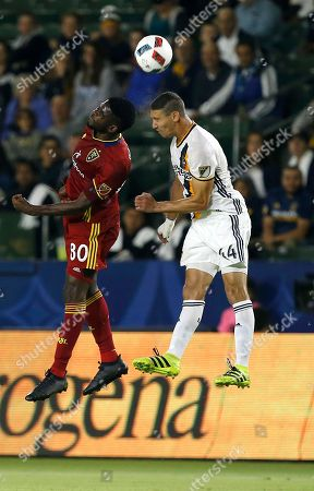 Olmes Garcia, Daniel Steres Real Salt Lake forward Olmes Garcia (80) and Los Angeles Galaxy defender Daniel Steres (44) vie for the ball during the first half of a knockout round MLS playoff soccer match in Carson, Calif