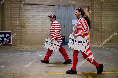 Donna Cancassi and her son Douglas Robinson arrive for a Republican vice presidential candidate, Indiana Gov. Mike Pence campaign stop in Bensalem, Pa