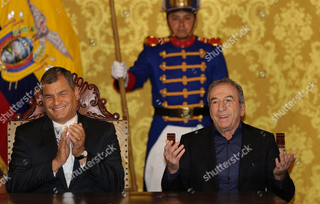 "Ecuador's President Rafael Correa, left, welcomes Spain's singer-songwriter Jose Luis Perales before awarding him the medal ""Orden Nacional al Mérito en el Grado de Oficial ""in Quito, Ecuador"
