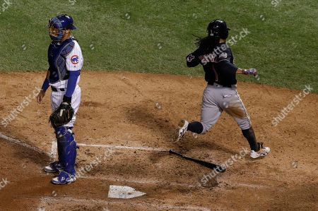 Cleveland Indians' Michael Martinez scores past Chicago Cubs catcher Willson Contreras during the seventh inning of Game 3 of the Major League Baseball World Series, in Chicago. Martinez scored from third on a hit by Coco Crisp