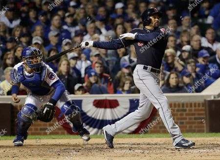 Cleveland Indians' Coco Crisp hits an RBI single during the seventh inning of Game 3 of the Major League Baseball World Series against the Chicago Cubs, in Chicago