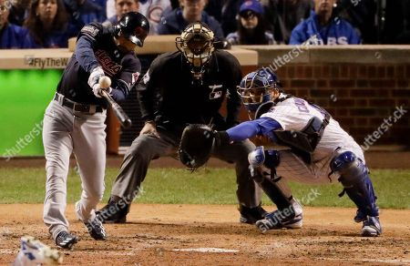 Cleveland Indians' Coco Crisp hits a RBI-single against the Chicago Cubs during the seventh inning of Game 3 of the Major League Baseball World Series, in Chicago