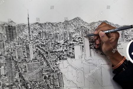 Stephen Wiltshire British artist Stephen Wiltshire draws Mexico City from memory, in the lobby of the BBVA Bancomer Tower on Paseo de la Reforma, in Mexico City . The autistic artist is spending five days creating a panoramic drawing of the megalopolis from memory after taking a sole helicopter flight over the city. Since 2005, the artist has drawn similar large-scale cityscapes of cities including Tokyo, Rome, Dubai, Shanghai, and New York
