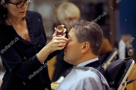 Bjarni Benediktsson of The Independence Party gets make up done prior to a TV show in Reykjavik, Iceland, . Parliamentary elections were held in Iceland on Saturday, with more than 250,000 voters entitled to elect 63 members of the Althing parliament