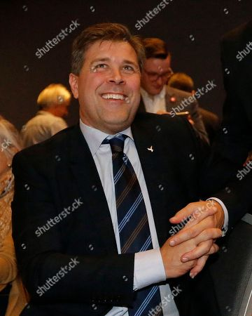 Bjarni Benediktsson of The Independence Party smiles after the first results in Reykjavik, Iceland, . Parliamentary elections were held in Iceland on Saturday, with more than 250,000 voters entitled to elect 63 members of the Althing parliament