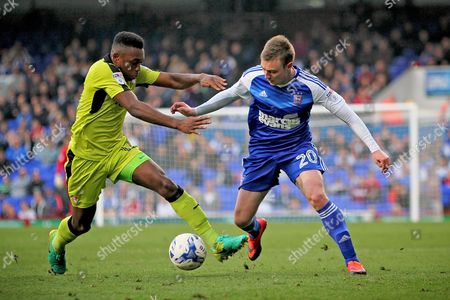Ipswich Town forward Freddie Sears (20) takes on Rotherham United midfielder Darnell Fisher (17) during the EFL Sky Bet Championship match between Ipswich Town and Rotherham United at Portman Road, Ipswich